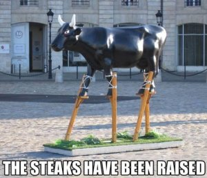 funny-statue-bull-stilts-sculpture